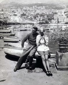 A behind-the-scenes photo of Grace Kelly with Cary Grant on the set of Alfred Hitchcock's To Catch a Thief.
