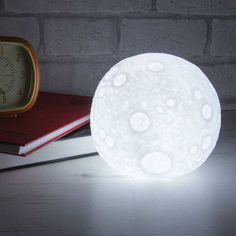 Moon LED Nightlight with on/off switches.Let the moon cast a glow over a bedside table or desk with this realistic Moonlight. Space mad boys and girls will love this cool nightlight and probably some of the Dads too . It will make the perfect stocking filler this Christmas . Batteries are included, it requires 3 button batteries LR44.Plastic / metal12 x 12 cm
