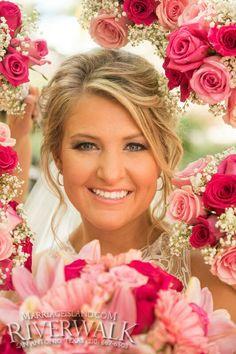 Bright seasonal bouquets in Shades of pink frame our beautiful Bride! www.MarriageIsland.com San Antonio Riverwalk Weddings (210) 667-6503