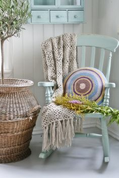 We have an old rocking chair. I just looked at it and thought 'oo, what about a new colour!' get a cheap rocking chair paint it white add yellow throw pillow.