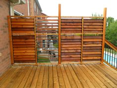 FLEX•fence creation by Thommoknockers Custom Decks. Louver extra privacy deck.