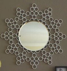 $10 DIY: $10 DIY PVC Sunburst Mirror.....could also use the toilet tissue roll tutorial instead of PVC.  A LOT easier and no one would ever know the difference!