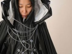"""Hyeona Yang and Joshua Noble, two students at the Copenhagen Institute of Interaction Design, built the 'Raincatch.' It's a suit that collects rainwater and filters it into drinking water."""