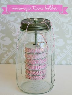 Mason jars can help keep your craft room tidy by storing everything from washi tape to buttons, but we really love this DIY project that makes it super easy to organize and dispense twine.