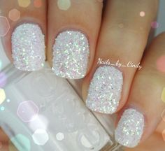 No instructions, but it looks like Essie white nail polish (maybe a pearlescent white) with glitter on top