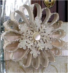 A cute, paper project to hang on a door or china cabinet. Tutorial. This is such a beautiful blog; check it out for more DIY projects!