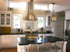 """paired windows in front of addition with stove/oven in between; make windows """"interesting"""" with arch tops, make ceilings vaulted; center island with sink"""