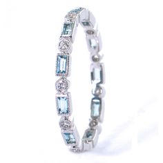Stacker with bezel round diamonds and baguette blue topaz -- my husband's birthstone