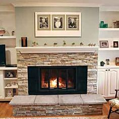 A new fireplace surround, hearth, and mantel lend this space a lighter, brighter look. Built-in shelves and base cabinets on either side provide both open and closed storage.