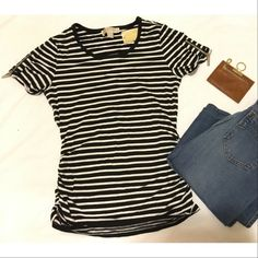 MICHAEL KORS ZIPPER SLEEVE TSHIRT STRIPES NWT. Never worn. Authentic Michael Kors. Size small, however this shirt is stretchy. Sleeves have silver zipper embellishments. Features side ruching, very flattering. No flaws rips or stains. No trades no PayPal. Offers welcome ! Black and white. MICHAEL Michael Kors Tops Tees - Short Sleeve