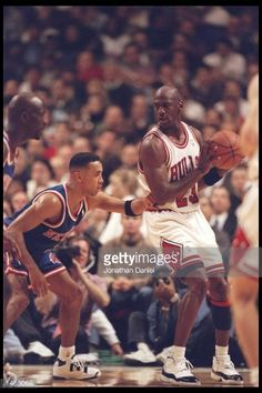 Guard John Starks of the New York Knicks tries to guard guard Michael Jordan of the Chicago Bulls at the United Center in Chicago Illinois The Bulls...