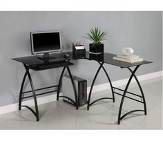 Corner Computer Desk - This contemporary desk offers a sleek, modern design crafted from durable steel and thick, tempered safety glass. The L-shape provides a corner wedge ideal for space-saving needs that is both attractive and simple. Includes a universal, autonomous CPU stand and a sliding keyboard tray. This desk compliments any room and is the perfect addition to any home office. Ships ready-to-assemble with necessary hardware and tools