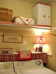 Red & white laundry room - this pin doesn't link to the source. Great idea for my laundry room behind the washer. Laundry Area, Laundry Room Storage, Laundry Room Design, Laundry In Bathroom, Laundry Closet, Laundry Room Curtains, Laundry Cupboard, Laundry Shelves, Laundry Tips