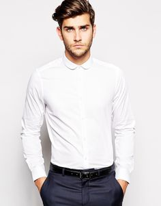 """Smart shirt by ASOS Lightweight, crisp fabric Curved collar Button placket Regular fit - true to size Machine wash 55% Cotton, 45% Polyester Our model wears a size Medium and is 188cm/6'2"""" tall Click here to shop our range of ties ."""