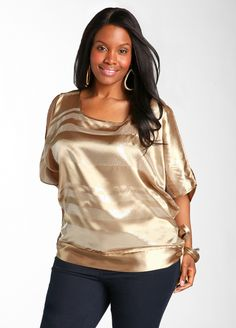 Plus size cold shoulder sequin blouse from Ashley Stewart $31.60.