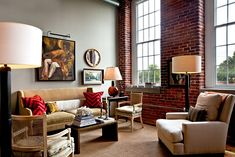 Steely gray offers wonderful visual contrast to the red brick in the living room