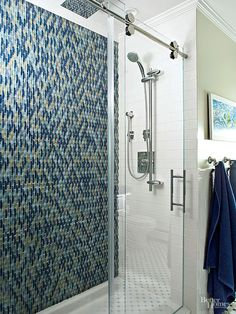 With nearly infinite color, material and designs available, customizing a shower with tile has never been easier! Find more bathroom design ideas here: http://www.bhg.com/bathroom/remodeling/planning/bath-details/?socsrc=bhgpin042015showertile&page=4