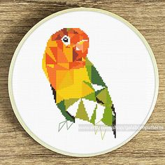 Tittle: Geometric lovebird Joint project with villavera.etsy.com (based on geometric artwork of villavera)  This PDF counted cross stitch pattern available for instant download.  Skill level: Beginner.  Pattern size (without white borders around): stitches: 95h x 65w ready design: 6.8h x 4.7w for 14-count fabric. You can frame it in 8x10 frame  Floss: 13 DMC colors  14-count Aida fabric  This PDF pattern include: • image of finished design • description • black and white symbols chart •…