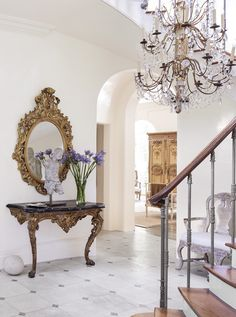 New Orleans based designer, Tara Shaw, has the classicism of Old World coursing through her veins. She is known and celebrated for her sophisticated designs featuring collections of highly curated antiques, rich glamorous textiles, tone on tone color palette paired with contemporary elements.  Neoclassical and Louis XV elements pop against the brilliant whites of her home foyer, welcoming her and her guests to her beautiful home.