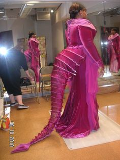 Lead Dragon Costume. I really like this. Would need to fashion a headpiece of some sort and gloves with claws. The Doo-Wop Girls should have coordinating dresses with flame headpieces.