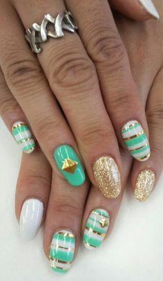 Cute aqua and gold nails