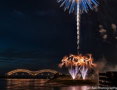 Memphis photograph of fireworks in downtown Memphis along the Mississippi. Hernando-Desoto bridge in the background.