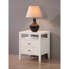 A gloss finish makes this white two-drawer nightstand an upscale addition to your bedroom decor. Made of rubberwood and featuring two drawers and a shelf, this nightstand looks luxurious and offers plenty of space for clocks, books, etc.