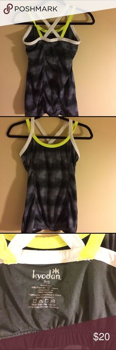 Kyodan strappy workout shirt size small EUC black, gray, white and yellow workout shirt with built in bra. Smoke free home. Bundle to save more Kyodan Tops Tank Tops