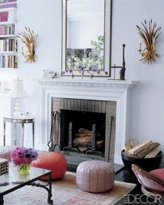 A pair of gold-leafed sheaf sconces from Downtown flank the living room mantel, which is original to the apartment.
