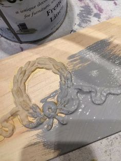 Wreath and ribbon molding. Paint over board and molding in one easy step.