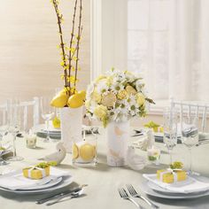 Lemon yellow wedding centerpieces and decor with white and yellow flowers by Bella by Sara