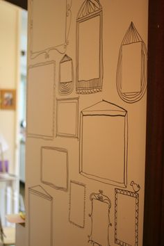 Draw 'frames' on the wall and blu-tac your kids artwork - easy to change and doesn't need lots of holes!