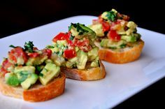 ½ loaf French bread, 1 clove garlic, 2 Tbsp olive oil, 2 tomatoes, medium chopped 2 avocados, medium chopped  1/3 cup finely chopped onion ¼ cup chopped cilantro 2 Tbsp freshly squeezed lime juice, ½ tsp salt  ¼ tsp pepper