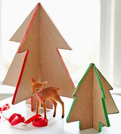 Have Santa-ready kiddos? Spare the expensive breakables and try these classic cardboard trees on for size. With a so-easy template and only two materials required, these pretty satin-edged trees are just the touch your sprightly home needs. Budget project price: $4  /
