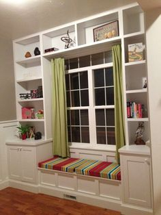 Built in bookshelves around the window with a seat for daydreaming.
