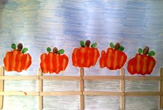 """Five Little Pumpkins"" fist print craft,   from mypreschool-crafts.com. Lots of great ideas for fall and Halloween crafts for kids."