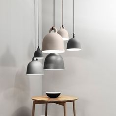 A pendant lamp in the form of a bell with a soft industrial feel. Bell fits beautifully in the kitchen, living room, bedroom, hallway and office environment. Hang a mix of sizes in a cluster, and achieve a dramatic visual effect, use a large Bell over the dinner table, or hang the small ones in pairs in the kitchen.