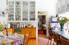 Laurie and Bruce Rabe's gorgeous, handicapped-accessible house exudes love and I think their kitchen is especially beautiful. The house is so warm and quirky.