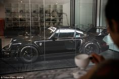 Vroom with a view! Man builds a glass Porche garage in his lounge Man Cave Garage, Garage House, Dream Garage, The Glass Palace, Ultimate Garage, Cool Garages, Modern Garage, Garage Cabinets, Garage Apartments
