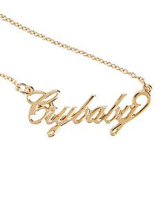 "<p>Get your hands on this gold tone Melanie Martinez ""Crybaby"" nameplate necklace, matching Melanie's very own! Now you can cry if you want to.</p>  <ul> <li>16"" chain; 3"" extender</li> <li>Alloy</li> <li>Imported</li> </ul>"