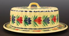 QUIMPER POTTERY COVERED CHEESE DISH. Both pieces marked 'F. 221 D. 201 C.G,' plate with Quimper, France mark. Underplate measures 10 inches in diameter, cover measures 3 x 7.5 inches.