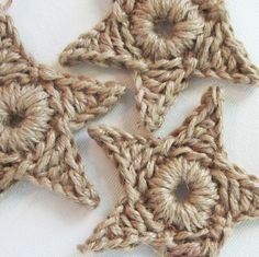 "set of 3 large primitive jute star ornamentsFrom sosorosey   Primitive, rustic, natural....so many possibilities <3    Jute stars are crocheted from heavy duty twine. They measure 4.25"" across, and come strung with a loop for hanging.    Lovely tied on top of packages, and perfect for those non-weight bearing Christmas tree limbs."