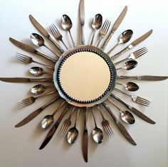 Awesome mirror or clock for the kitchen. Collect silverware at thrift stores.