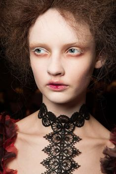 Alexander McQueen Fall 2015 Ready-to-Wear Fashion Show Beauty-- they have a weird look around their eyes? No mascara and like red underneath or something