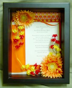 shadow box idea- with program, save the date, invite, engagement pic and wedding pic?
