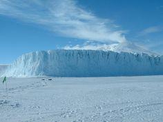 Antarcticas Barne Glacier where it meets the frozen ocean with Mt Erebus volcano smoking in the background  #landscape #antarcticas #barne #glacier #meets #frozen #ocean #erebus #volcano #smoking #background #photography