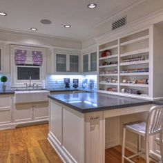 laundry & craft room combo. farmhouse sink. subway tile. white cabinets. open shelves. under cabinet lighting. LOVE the huge double sided peninsula for crafting.
