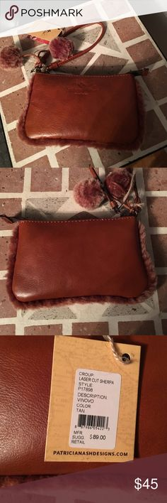 Patricia Nash leather wristlet Gorgeous! Leather with Sherpa pom poms and edges, great size to hold the necessities. Previously listed and sold a berry one, and got my hands on one more soon to be listed. Lowest price here, please no lowballing  this is a cognac color but I listed as tan, much prettier in person, rich shade, as is the berry Patricia Nash Bags Clutches & Wristlets