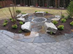 refinish around our fire pit with stamped concrete or flagstone instead of pea gravel