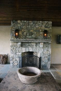 Beautiful outdoor fireplace with gasoliers in this outdoor room. Love the herringbone brick and wood ceilings.